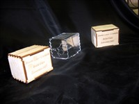 Wooden boxes with interlocking fingerjoints, etched on the outside